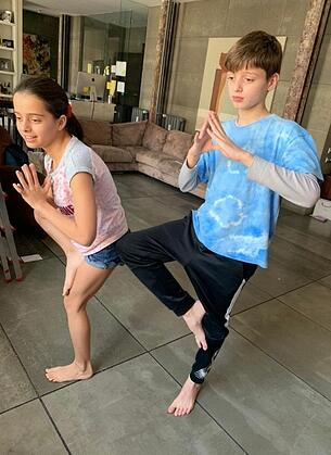 Children doing yoga promotes happiness and minfulness and fun