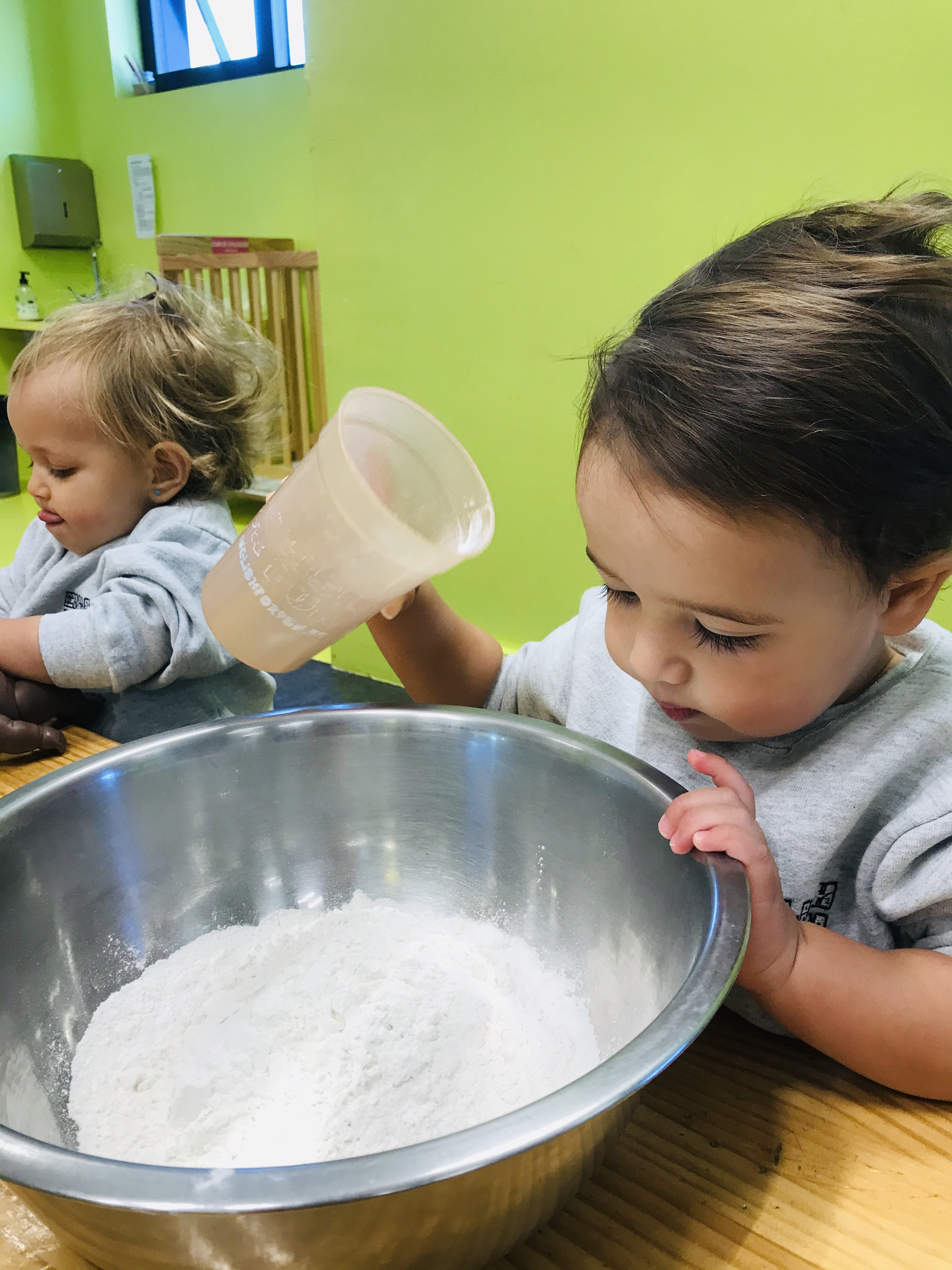 Children feel empowered when they pour the ingredients and make them into something that they can eat later.